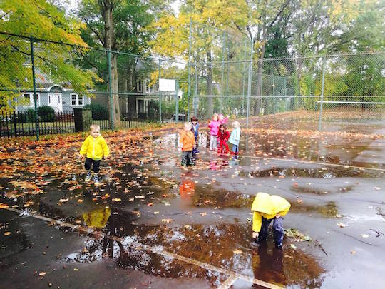 Preschool playing in the rain